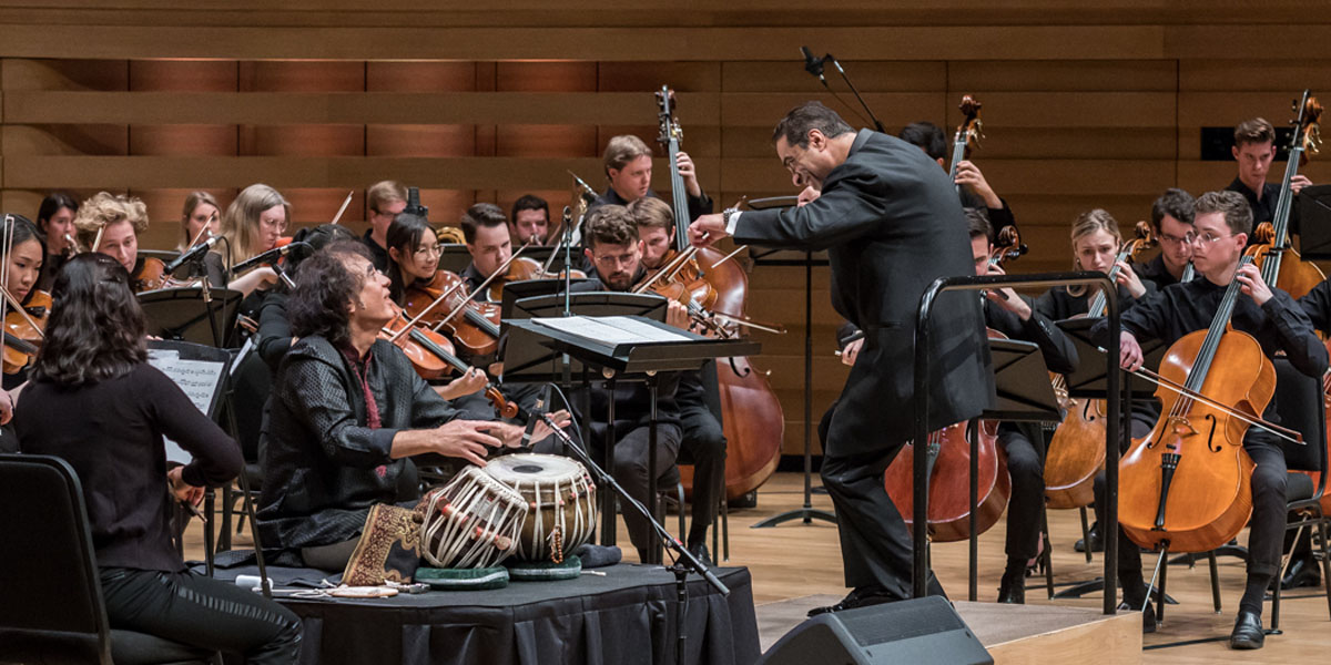 Zakir Hussain and the Royal Conservatory Orchestra conducted by Zane Dalal. Photo credit: The Royal Conservatory/Koerner Hall; Lisa Salulensky